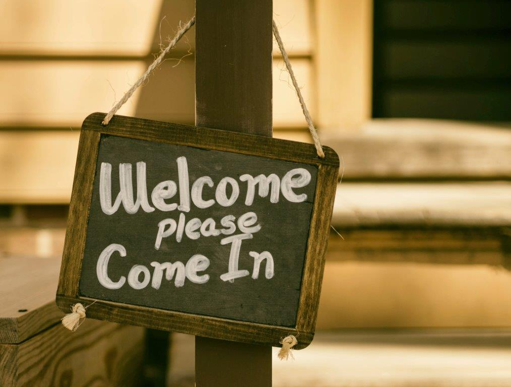 Sign saying Welcome please come in