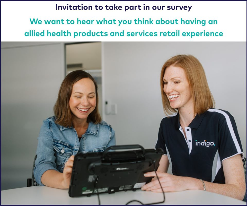 two professionals smiling at a screen, text banner reads Invitation to take part in our survey