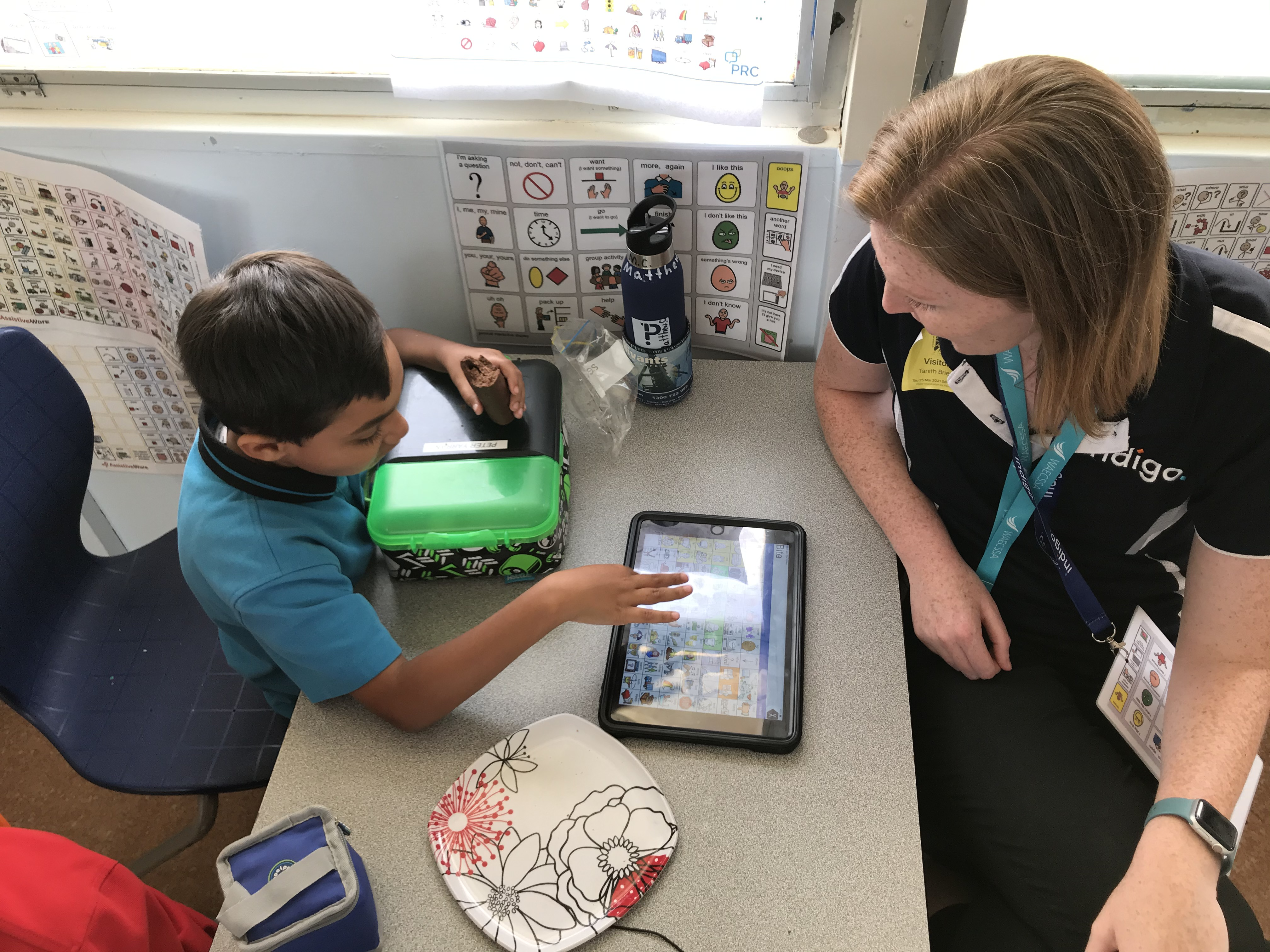 Indigo HP & young student in school using an AAC device
